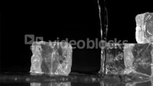 Ice cubes in super slow motion receiving water