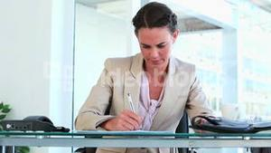 Businesswoman working at her office