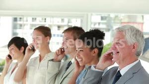 Business people on the phone laughing