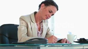 Businesswoman working in her office