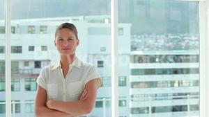 Businesswoman posing the arms crossed