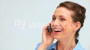 Laughing businesswoman on the phone