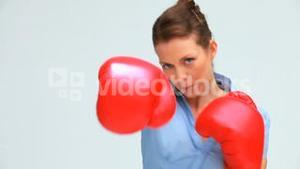 Woman with tied hair boxing