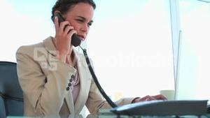 Businesswoman picking up the phone