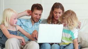 Family watching something on a laptop together