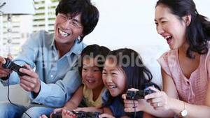 Family playing a games console together