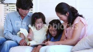 Family reading a ebook between them