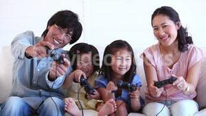 Family happily playing a games console together