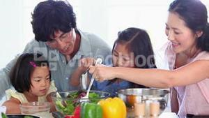 Family preparing a salad together