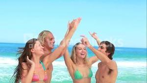 Four friends party at the beach together