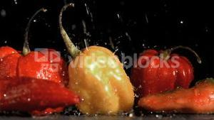 Raindrops falling in super slow motion on vegetables