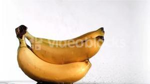 Delightful bananas in super slow motion being wet