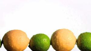 Lemons and limes in super slow motion being wet