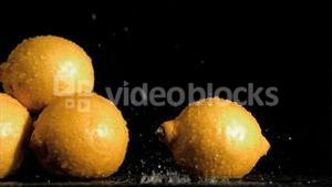 Delightful lemons in super slow motion receiving water