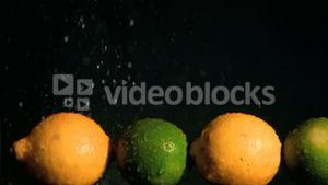 Limes and lemons in super slow motion receiving water