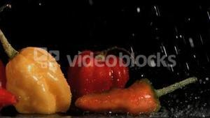 Tasty vegetables in super slow motion receiving raindrops