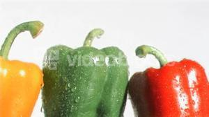 Peppers in super slow motion receiving water