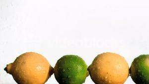 Limes and lemons in super slow motion being wet