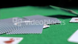 Playing card in super slow motion landing