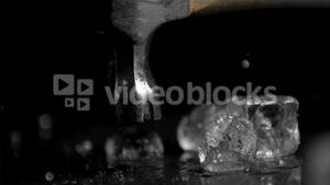 Hammer in super slow motion breaking ice cubes