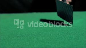 Two aces thrown in super slow motion on a table