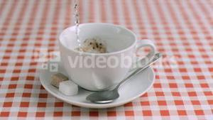 Water poured in super slow motion in instant coffee