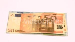 Wind blowing in super slow motion to show one hundred euro banknotes