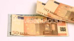 Banknotes flying away in super slow motion showing one hundred banknote
