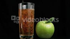 Apple juice poured in super slow motion