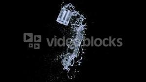 Glass thrown in super slow motion with water splashes