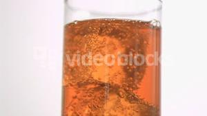 Energy drink in super slow motion with ice
