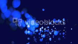 Blue bubbles floating in super slow motion in the air