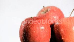 Red apple watered in super slow motion
