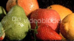 Fruits watered in super slow motion