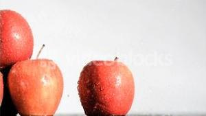 Gala apples watered in super slow motion