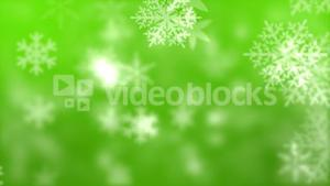 Snowflakes against green background