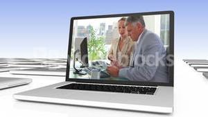 Business video on digitally created laptop