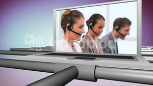 Smiling people working in a call centre