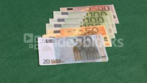 Bank notes in super slow motion appearing