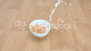 Bowl of cereals in super slow motion falling
