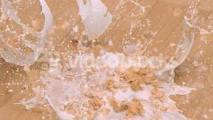 Bowl of cereals in super slow motion breaking