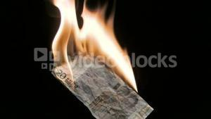 Euro note in super slow motion burning