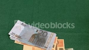 Bank notes in super slow motion flowing