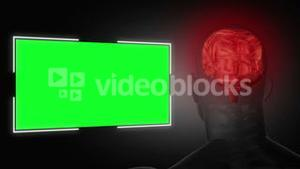 Human head next to a green screen