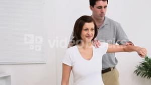 Physiotherapist manipulating the arm of a patient