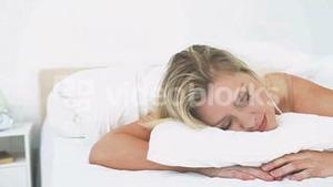 Woman dreaming on her bed