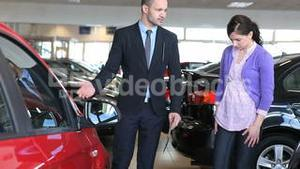 Businessman presenting a car