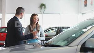 Businessman showing a car to a woman