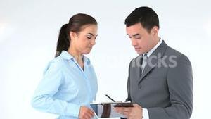 Business people signing a contract on a clipboard