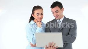 Business people holding a laptop